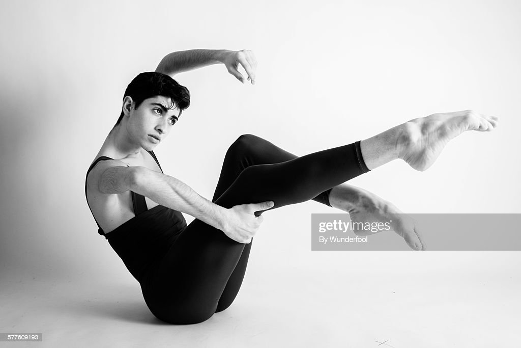 Male ballet dancer in tights with his legs up : Stock Photo