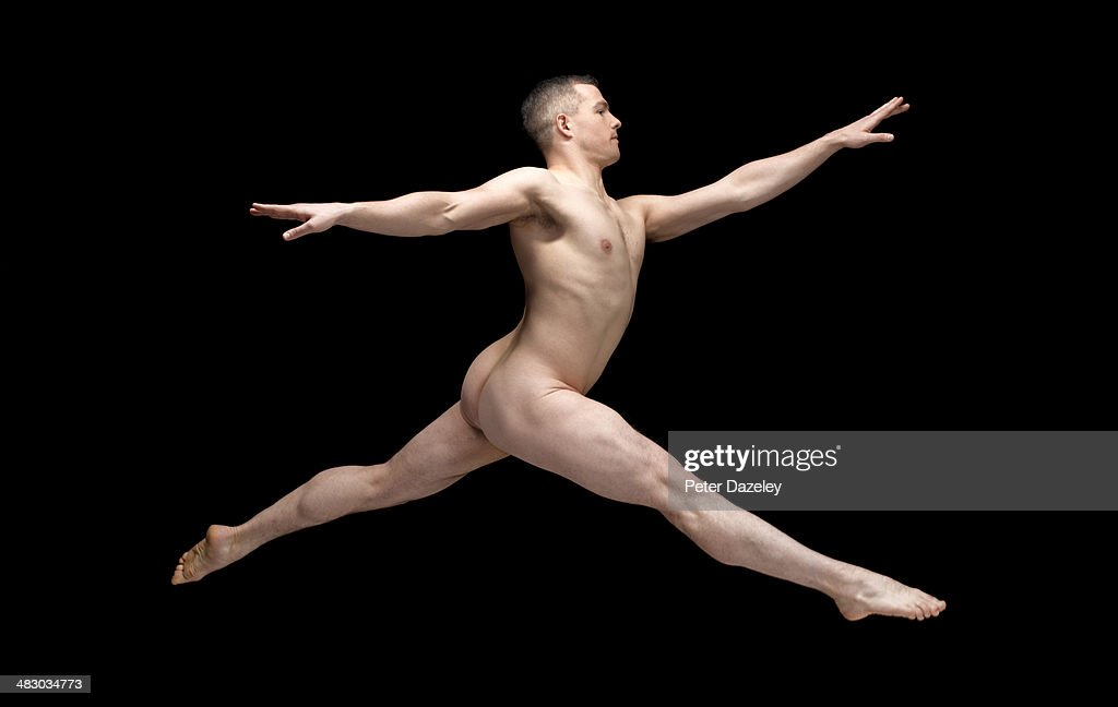 Male ballet dancer jumping, nude, side view : Stock Photo