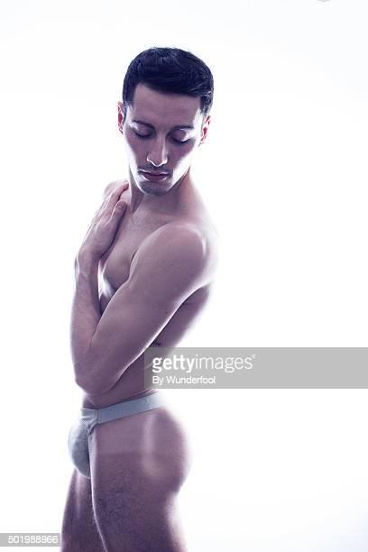 male ballet dancer posing against backlight - naakte man en profiel stockfoto's en -beelden