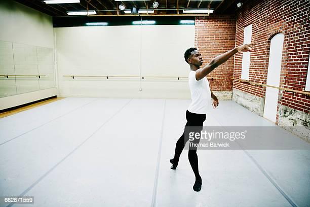 Male ballet dancer practicing in dance studio