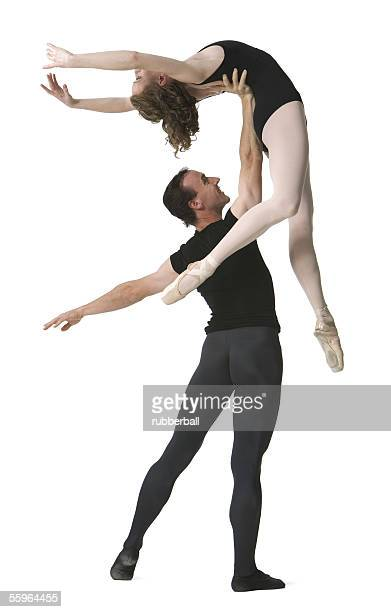 Male ballet dancer supporting a female ballerina