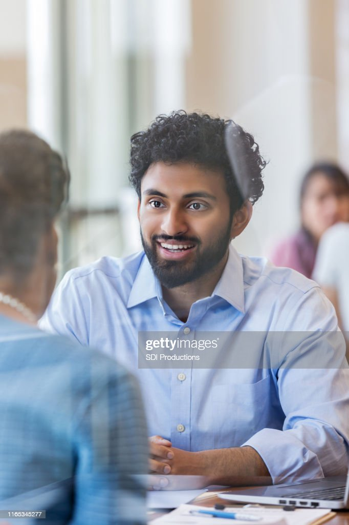 Male bank officer discusses loan with customer : Stock Photo