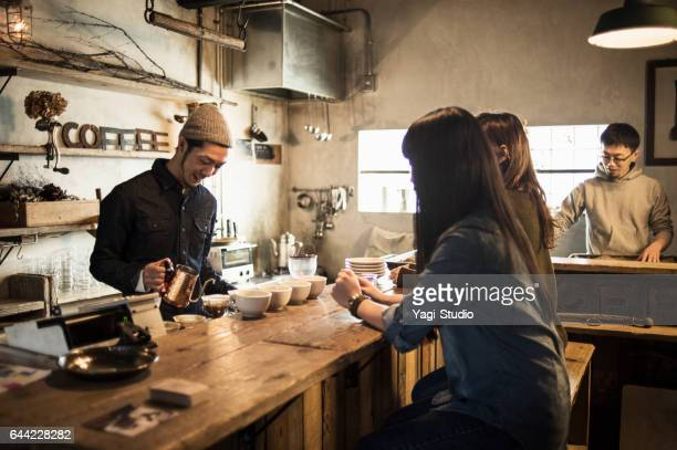 Male barista making a coffee in coffee shop
