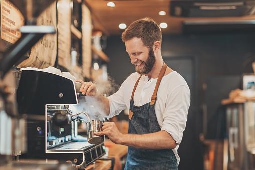 Male barista making cappuccino 842948570