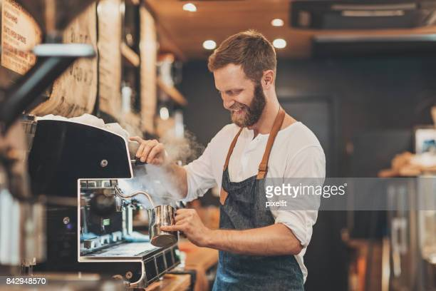 male barista making cappuccino - preparation stock pictures, royalty-free photos & images
