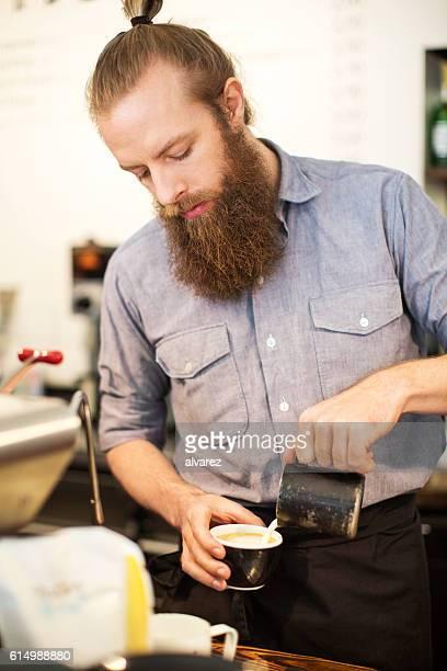 Male barista preparing coffee