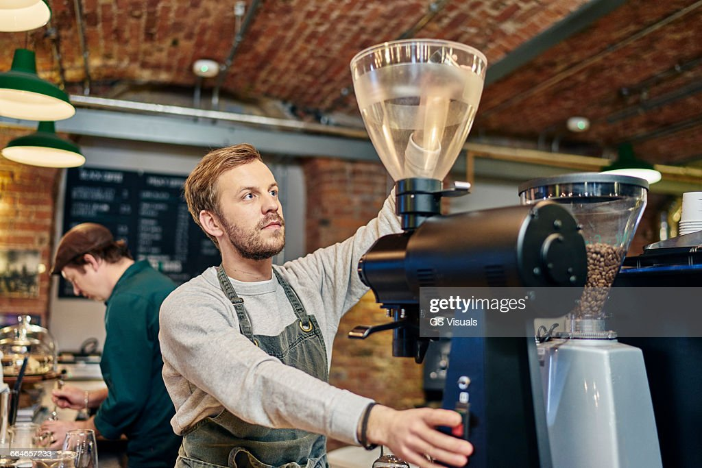 Male Barista Using Coffee Machine At Coffee Shop Kitchen Counter ...