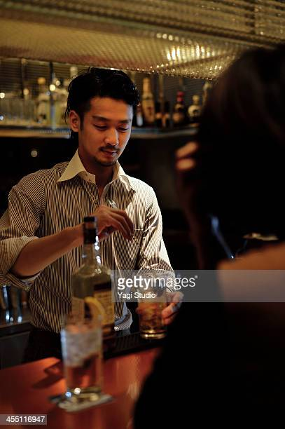 Male bartender is making a cocktail