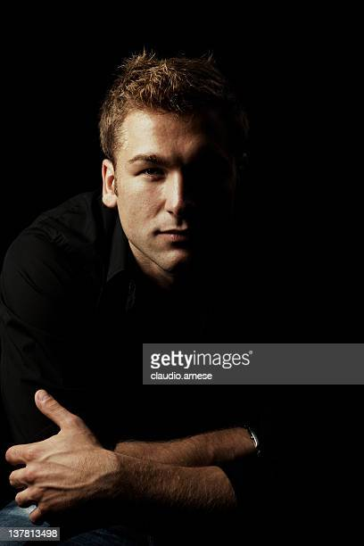 male beauty portrait with black background. color image - high contrast stock pictures, royalty-free photos & images