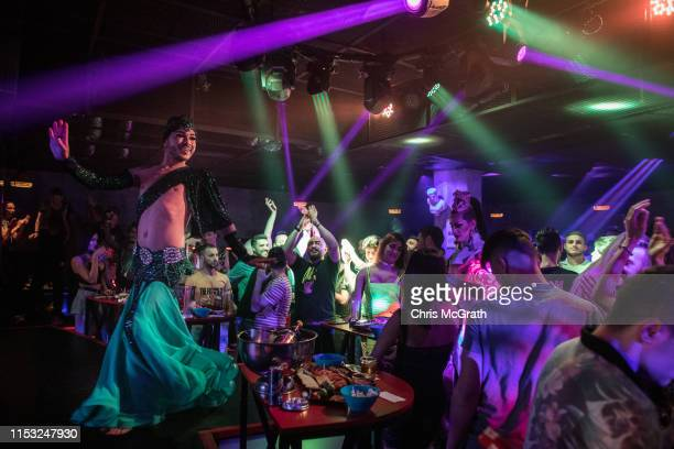 """Male belly dancer Segah dances onstage at a nightclub on June 02 2019 in Istanbul Turkey Male belly dancers or """"zennes"""" date back to the final..."""