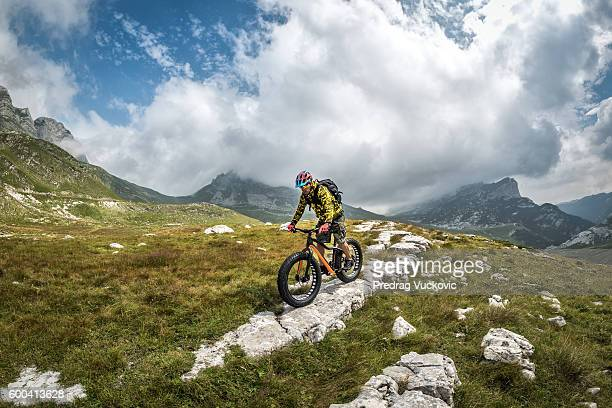 male bicycle rider in the mountains - montenegro imagens e fotografias de stock