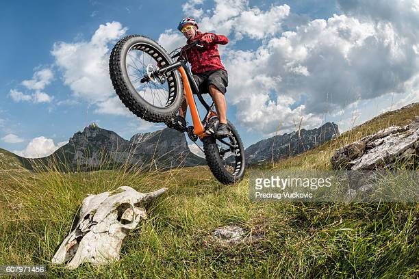 Male bicycle rider in the mountains