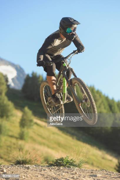 Male biker performing extreme stunts with mtb