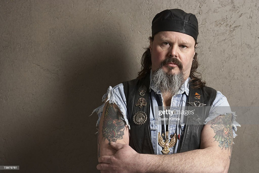 Male biker with tattoos on arms, portrait : Stock Photo