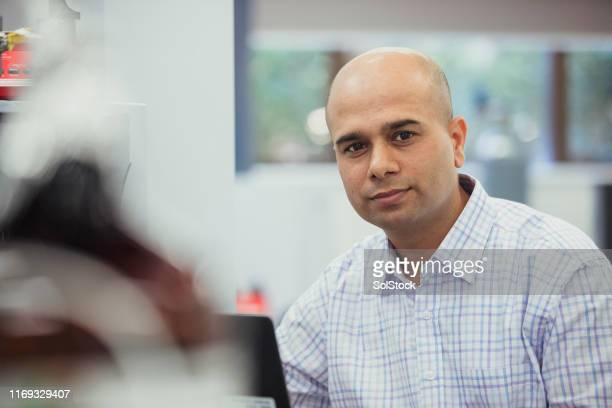 male biochemist portrait - nepalese ethnicity stock pictures, royalty-free photos & images