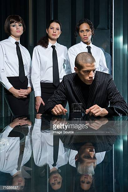 Male boss with female employees
