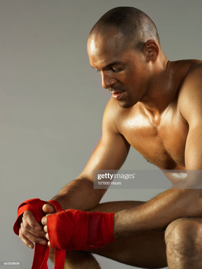 Male Boxer Adjusting Bandages on His Hands : Stock Photo