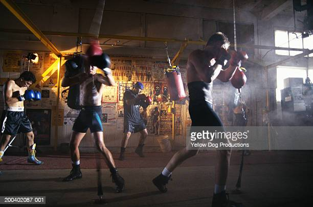 Male boxers working out in gym (blurred motion)