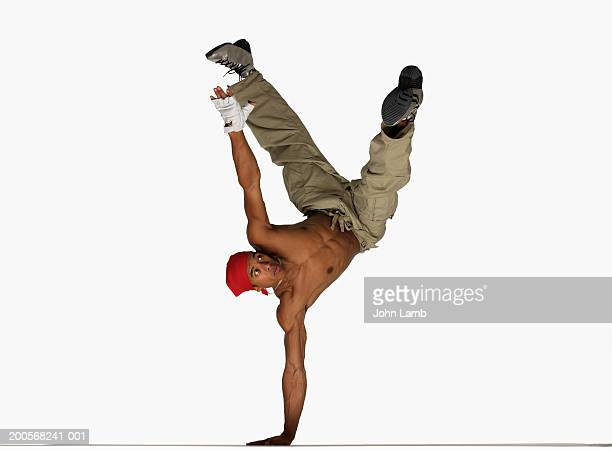 Male breakdancer balancing on one hand