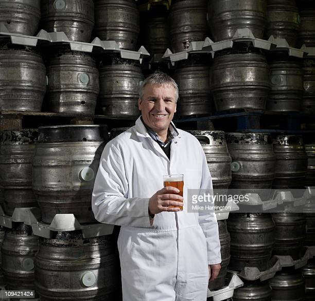 Male Brewer Holding A Beer in Brewery