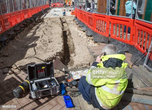 Male BT Openreach broadband technician working in town center of Ipswich Suffolk England UK