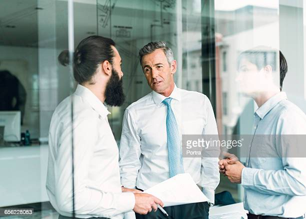 Male business colleagues discussing in office
