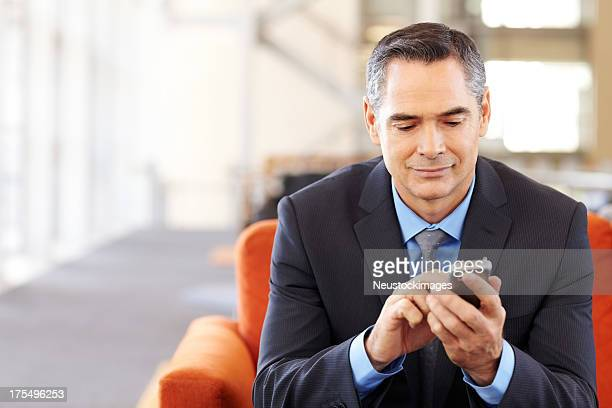 Male Business Executive Text Messaging