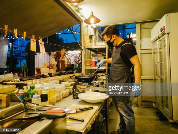 male business owner of food truck. - in flames i the mask stock pictures, royalty-free photos & images