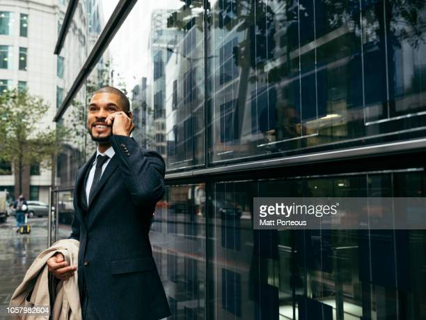 Male businessman smiling on the phone
