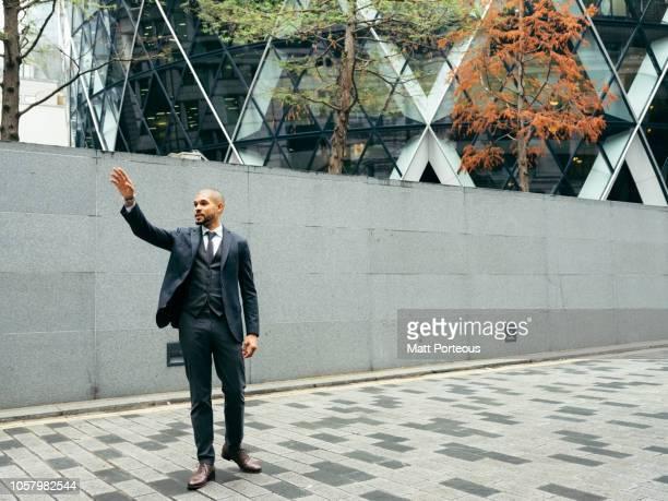 Male businessman waving