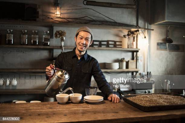 Male cafe owner preparing coffee in coffee shop