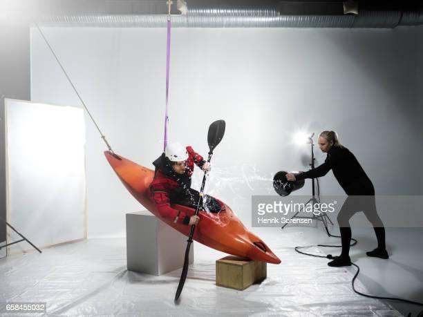 Male canoer being splashed in a studio