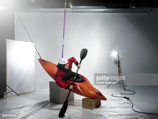 Male canoer in a studio