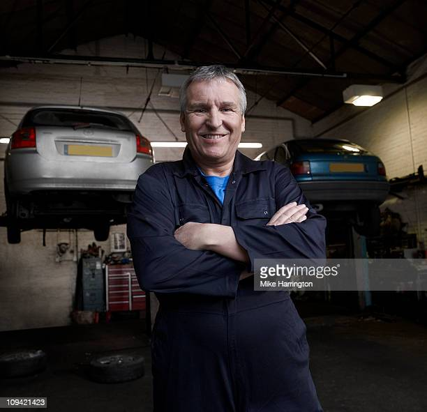 Male Car Mechanic Standing in Garage