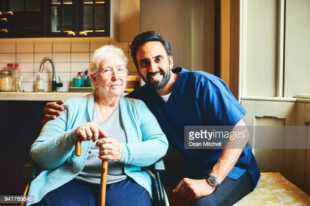 Male carer with beautiful senior female patient