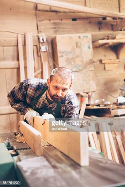 Male carpenter manifacturing at workshop