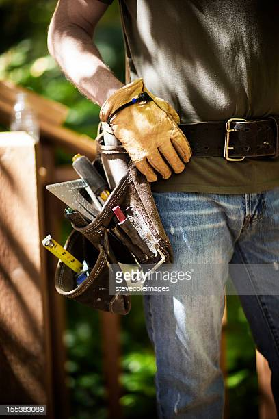 male carpenter wearing tool belt. - leather belt stock pictures, royalty-free photos & images