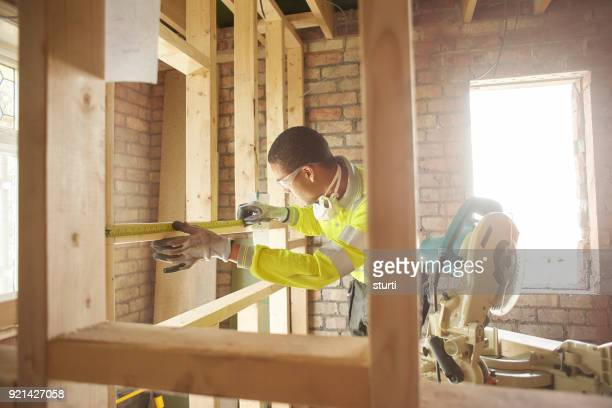male carpenter with chopsaw - foundation make up stock pictures, royalty-free photos & images
