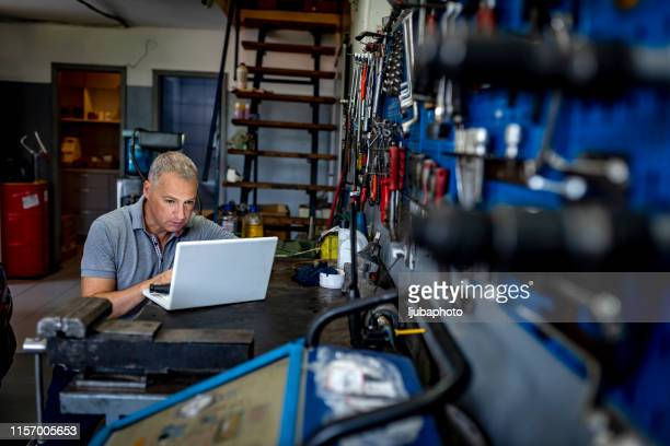 male carpenter working in his workshop - serbia stock pictures, royalty-free photos & images