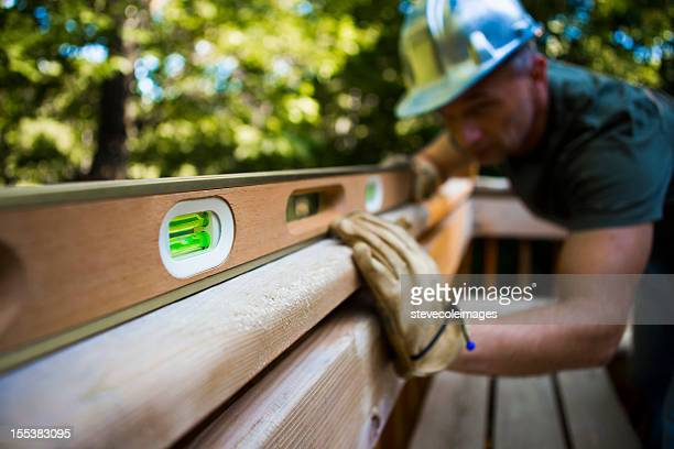 Male Carpenter Working With Spirit Level.