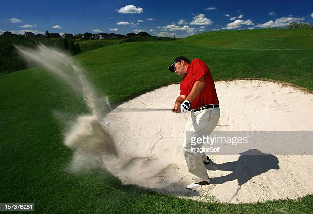 Male Caucasian Golfer Blasting Out of a Sand Trap