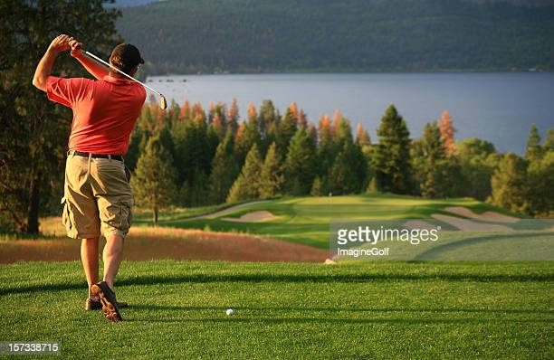 male caucasian golfer on the tee - lake bottom stock photos and pictures