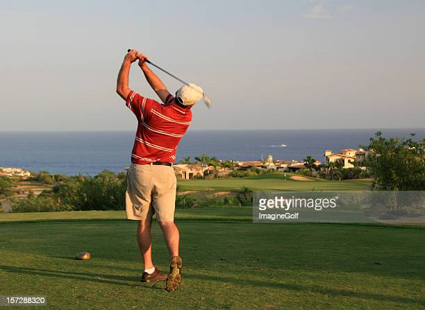 male caucasian golfer swinging in mexico - running shorts stock pictures, royalty-free photos & images