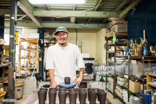 male ceramic artists making products in studio - art and craft product stock pictures, royalty-free photos & images