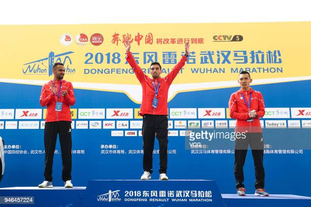 Male champions attend the medal ceremony of the 2018 Dongfeng Renault Wuhan Marathon on April 15 2018 in Wuhan Hubei Province of China