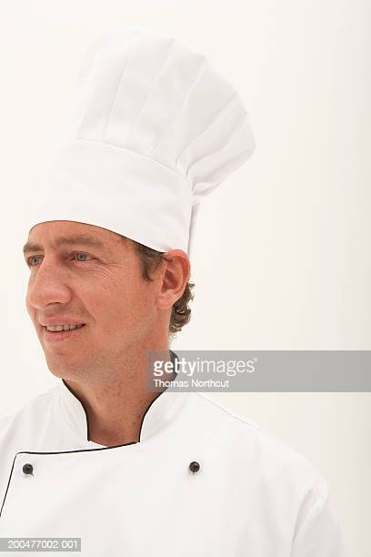 Male chef smiling, looking away