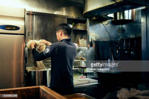 a male chef who prepares soup before opening the shop - chigasaki stock pictures, royalty-free photos & images