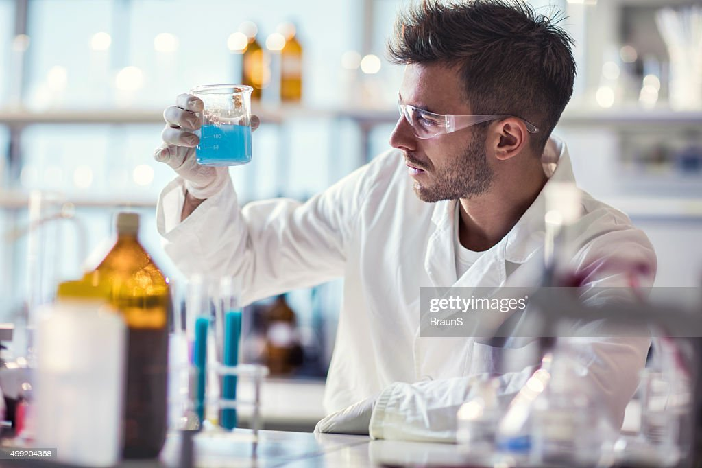 Male Chemist Working On Chemical Substances In A Laboratory Stock ...