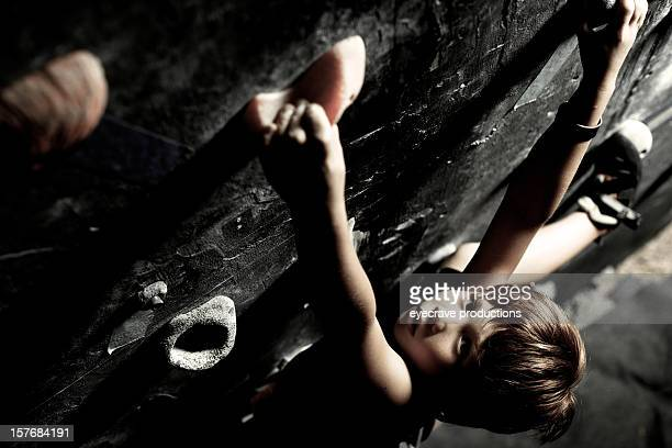 male child rock climber climbing gym