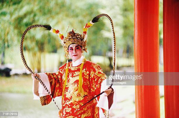 Male Chinese opera performer performing, Singapore